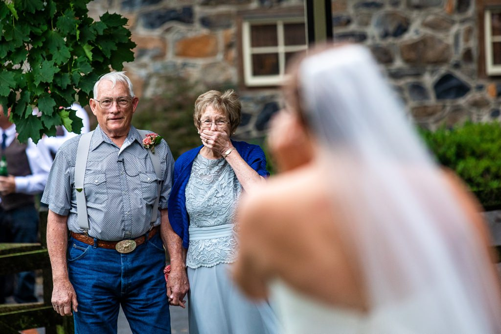 bride doing first look with grandparents