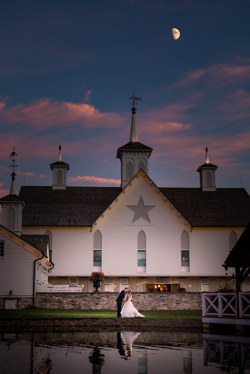 moon rising over the star barn wedding at sunset