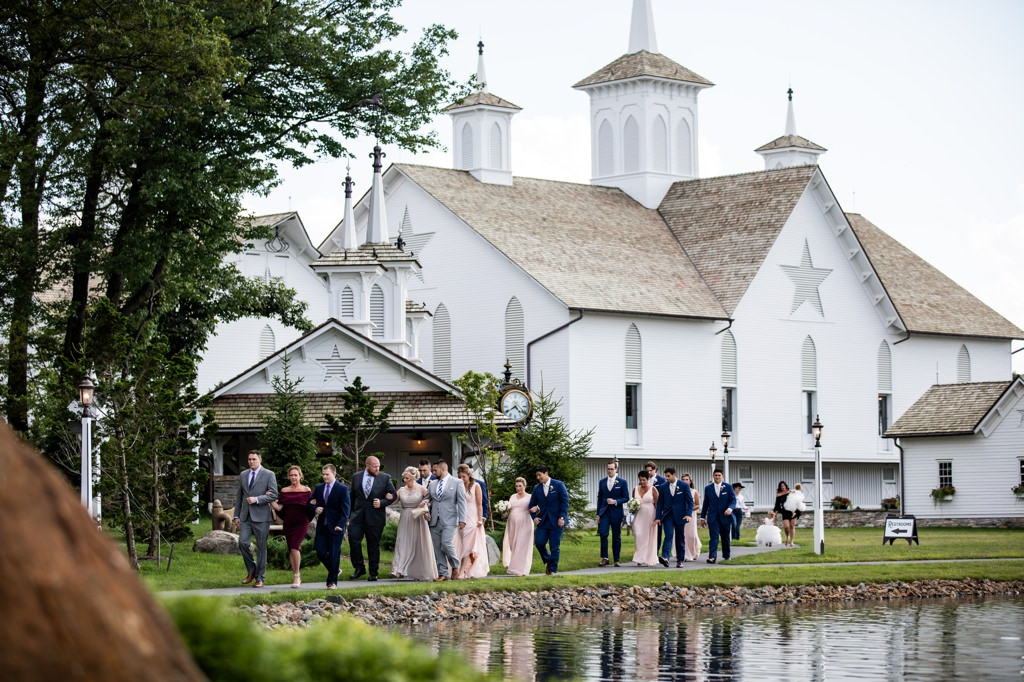 bridal party walking to ceremony at the star barn