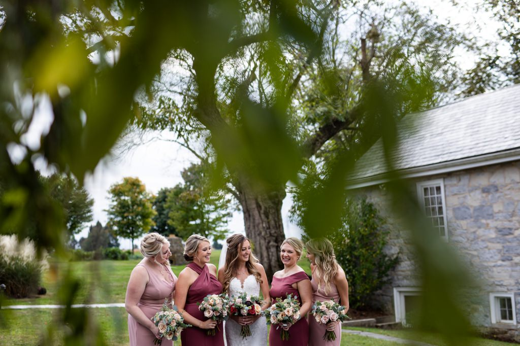 bridesmaids-laughing-outside-barn-at-silverstone