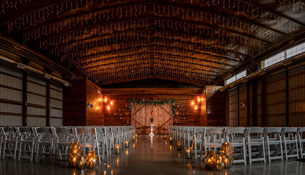 indoor wedding ceremony location at the barn at silverstone