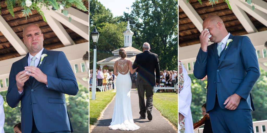 Groom crying as bride walks down the aisle at The Star Barn